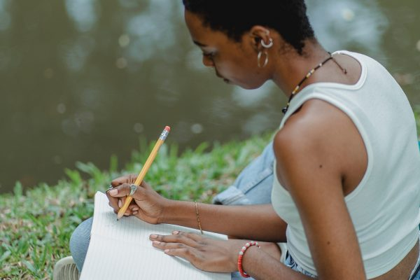 Lady writing in a journal outside