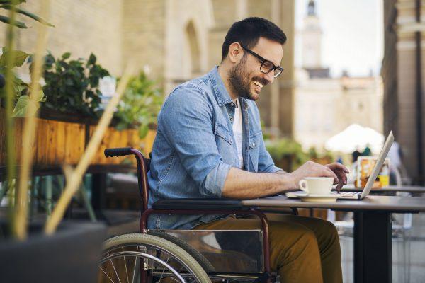 man in wheelchair at laptop