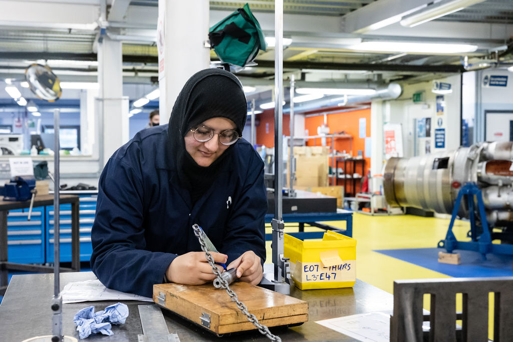 Female engineering student at work