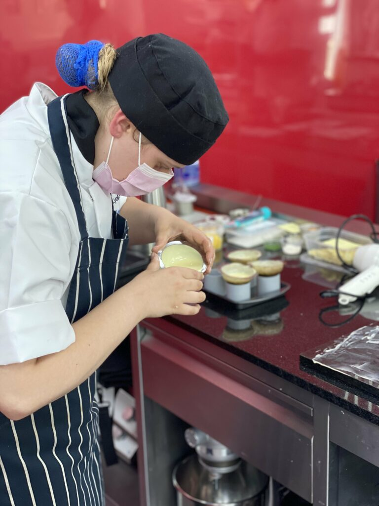 Catering students moulding chocolate