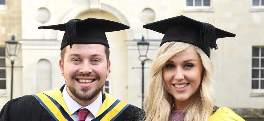 Man and woman graduating