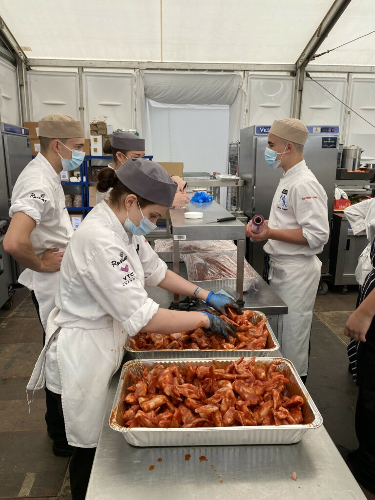 Catering students preparing food