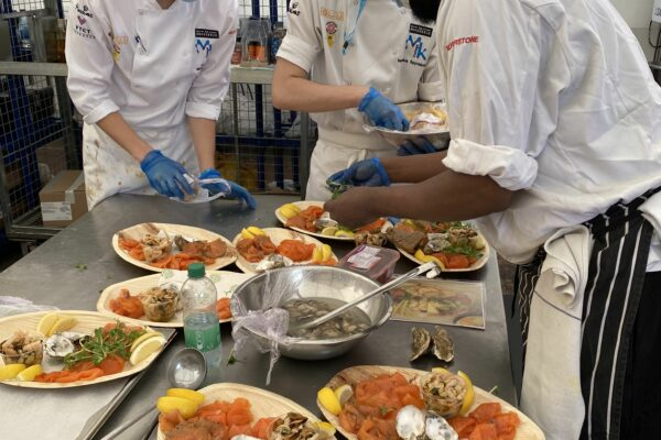 Catering students plating up food